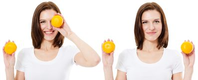 O modelo Girl da beleza toma laranjas O profissional compo Fatia alaranjada Beleza, cosméticos e conceito da forma fotografia de stock royalty free