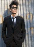 O modelo masculino na obscuridade compo Imagem de Stock Royalty Free