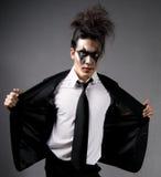 O modelo masculino na obscuridade compo Imagem de Stock