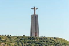O monumento de Cristo Rei de Jesus Christ em Lisboa, Portugal fotografia de stock royalty free