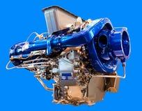O motor sob o fundo azul Fotografia de Stock Royalty Free