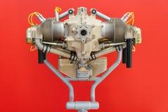 O motor sob o fundo vermelho Fotos de Stock Royalty Free