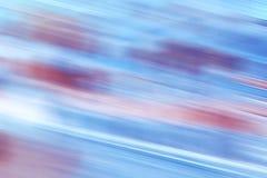 O movimento borrou o fundo abstrato ou o papel de parede azul e vermelho Foto de Stock Royalty Free