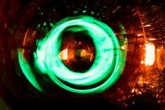 O movimento de incandescência abstrato de alta resolução do círculo borrou o fundo em vermelho vívido escuro, verde, amarelo, azu Imagem de Stock Royalty Free