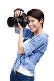 O mulher-fotógrafo bonito toma instantâneos imagens de stock royalty free