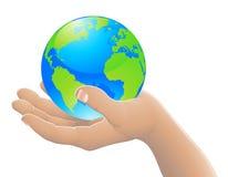 O mundo em seu conceito da mão Imagens de Stock Royalty Free