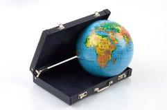 O mundo em uma mala de viagem Fotografia de Stock