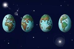 O mundo pintado nos ovos que mostram o ciclo da rotação do planeta E imagens de stock