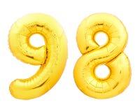 O número dourado 98 noventa e oito fez do balão inflável Foto de Stock Royalty Free