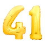 O número dourado 41 quarenta uns fez do balão inflável no branco Foto de Stock