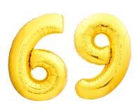 O número dourado 69 sessenta e nove fez do balão inflável Fotos de Stock