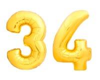 O número dourado 34 trinta e quatro fez do balão inflável Fotografia de Stock