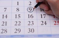 O número e a mão com um lápis Imagem de Stock Royalty Free