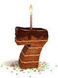 O número sete dá forma ao bolo de aniversário ilustração stock