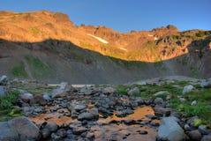 O nascer do sol, cabra balanç a região selvagem, estado de Washington Imagem de Stock