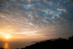 O nascer do sol e o algodão gostaram de nuvens Imagens de Stock Royalty Free