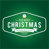 O Natal é tema do emblema Elementos das decorações Foto de Stock