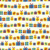 O Natal apresenta em seguido o teste padrão sem emenda do vetor Caixas de presente com as curvas vermelhas, amarelas e azuis em u ilustração royalty free