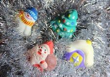 O Natal brinca feito a mão no ouropel de prata Fotografia de Stock Royalty Free