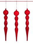 O Natal de vidro fundido vermelho Ornaments o ~ isolado Imagens de Stock
