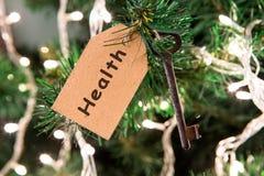 O Natal deseja o conceito - chave com inscrição na etiqueta foto de stock royalty free