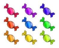 O Natal envolveu o grupo dos doces Doce empacotado colorido, presente em um pedaço de papel Fotos de Stock