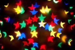 O Natal stars o fundo do bokeh Fotografia de Stock Royalty Free