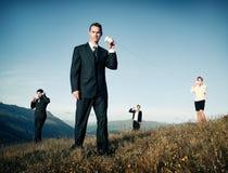 O negócio comunica-se com o conceito do telefone do copo de papel fora Imagens de Stock Royalty Free