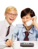 O negócio é divertimento porque é considerado por miúdos Foto de Stock Royalty Free