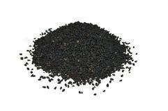 O nigella o mais atrasado e o mais atrasado semeia imagens das sementes Fotografia de Stock Royalty Free