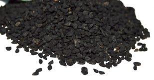 O nigella o mais atrasado e o mais atrasado semeia imagens das sementes Imagens de Stock Royalty Free