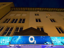 O2 at night. Sign on an O2 shop during night time - copy space above Stock Photography