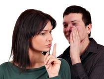 O noivo sussurra um segredo Fotografia de Stock