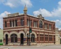 O ochraniacza budynek buduje czerwona cegła i biały piaskowiec Obrazy Stock