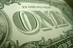 The O of the ONE is the focus of this close up from the reverse of the US dollar bill. royalty free stock images