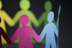 O origâmi dos povos da comunidade Imagem de Stock