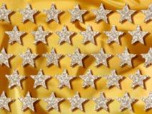 O ouro de Jewelery stars o fundo Fotografia de Stock