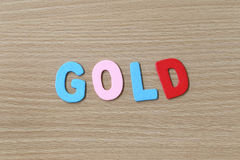 O ouro do texto colorido Fotografia de Stock