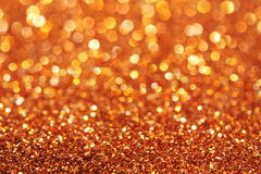 O ouro e as luzes suaves amarelas e alaranjadas abstraem o fundo Foto de Stock Royalty Free