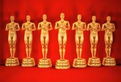 O ouro equipa no vermelho. Fotografia de Stock Royalty Free