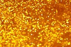 O ouro mancha o bokeh Imagem de Stock