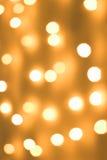 O ouro mancha o bokeh Fotos de Stock