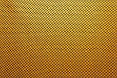 O ouro ou o amarelo textured o fundo com rasgos pretos imagem de stock