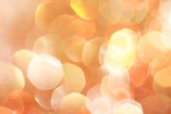 O ouro, prata, vermelho, branco, bokeh abstrato alaranjado ilumina-se, fundo defocused Imagens de Stock Royalty Free