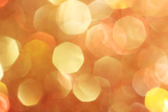 O ouro, prata, vermelho, branco, bokeh abstrato alaranjado ilumina-se, fundo defocused Imagens de Stock