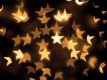 O ouro stars o fundo do bokeh Imagens de Stock Royalty Free