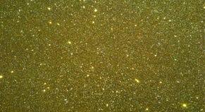 O ouro textured o fundo com fundo do efeito do brilho imagem de stock