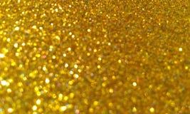 O ouro textured o fundo com fundo do efeito do brilho fotografia de stock royalty free