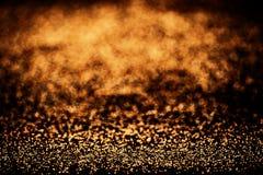 O ouro vislumbra o fundo com luzes douradas e pretas brilhantes spar fotos de stock