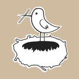 O pássaro constrói um ninho acolhedor Fotografia de Stock